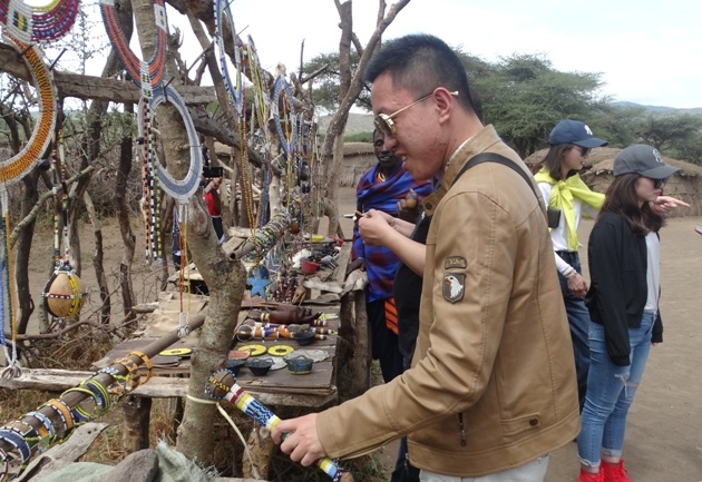Chinese Tourists excited by TANZANIA tourist attractions