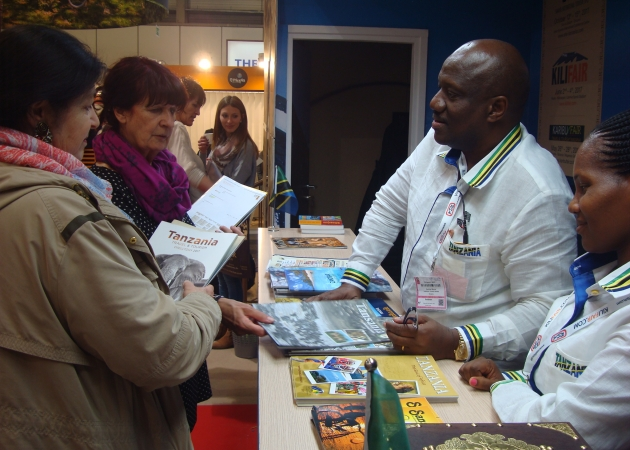The Tanzania Tourist Board's Marketing Manager Mr Geofrey Meena attends visitors Tanzania at Tanzania stand.