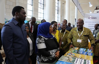 The Marketing Manager of Tanzania Tourist Board, Mr. Geofrey Meena explaing to the Vice President, Hon Samia Suluhu on TTB's publication when she visited the stand.